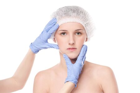 Medical face examination of beautiful woman by hands in glove - close-up portrait isolated on white Stock Photo - 16763723