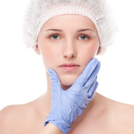 Medical face examination of beautiful woman by hands in glove - close-up portrait isolated on white Stock Photo - 16763730