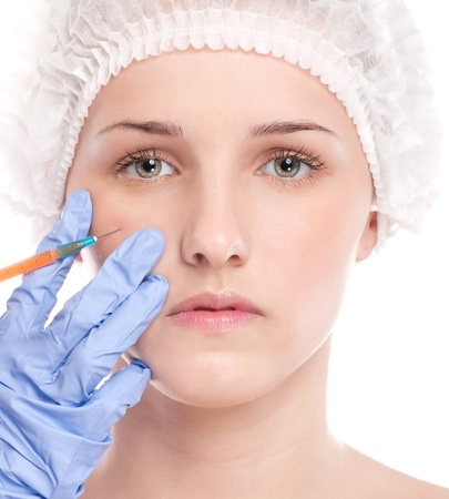 Cosmetic botox injection in the female face. Cheek zone. Isolated on white Stock Photo - 16763753