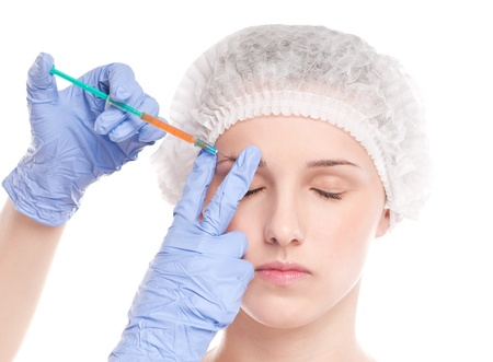 Cosmetic botox injection in the female face. Eye and eyebrow zone. Isolated on white Stock Photo - 16763740