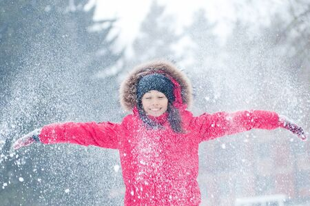 Happy young woman plays with a snow outdoor. Winter day Stock Photo - 16763761