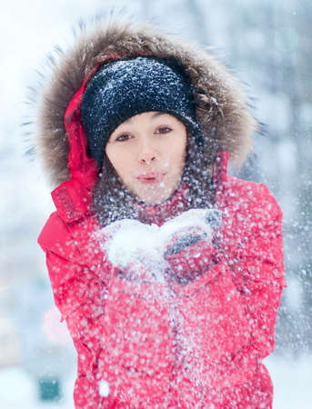 Happy young woman plays with a snow outdoor. Winter day Stock Photo - 16763755