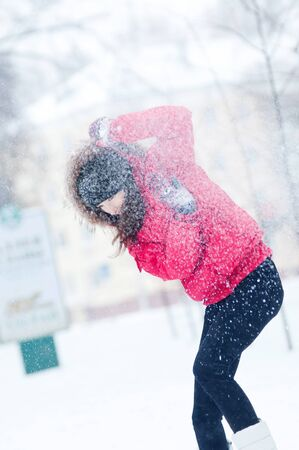 Happy young woman plays with a snow outdoor. Winter day Stock Photo - 16763722