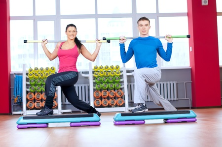 Young man and woman at the fitness gym is doing stretching exercises Stock Photo - 16890629