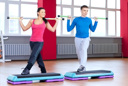 Young man and woman at the fitness gym is doing stretching exercises Stock Photo - 16763726