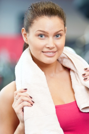 Young woman drinking water after sports. Fitness gym. Stock Photo - 16763724