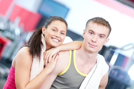 Man and woman after sport exercises. Fitness gym. Stock Photo - 16763714