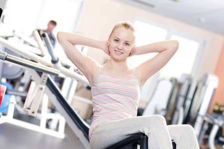 Young woman doing stretching exercise at the gym  Stock Photo - 18207924