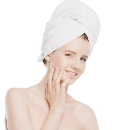 Close-up portrait of young woman with perfect health skin of face and bath towel on head. Isolated on white Stock Photo - 18207931