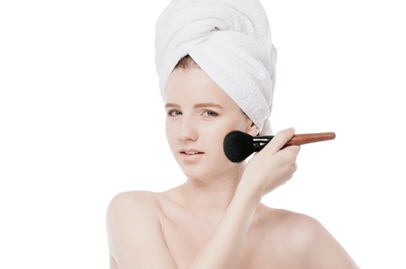 Close-up portrait of young beautiful woman with brush for make-up. Cheek zone Stock Photo - 18207925