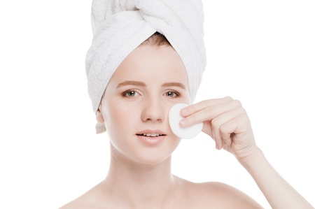 Close-up portrait of young woman with perfect health skin of face, bath towel on head and clean sponge. Isolated on white Stock Photo - 18207928