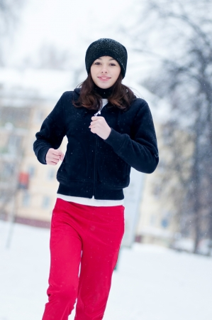 Young girl running on a cold winter day outdoor Stock Photo - 18207929