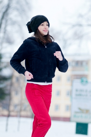 Young girl running on a cold winter day outdoor photo
