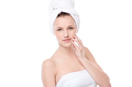 Close-up portrait of young woman with perfect health skin of face and bath towel on head. Isolated on white Stock Photo - 18440276