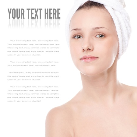 Close-up portrait of young woman with perfect health skin of face and bath towel on head. Isolated on white Stock Photo - 18440249