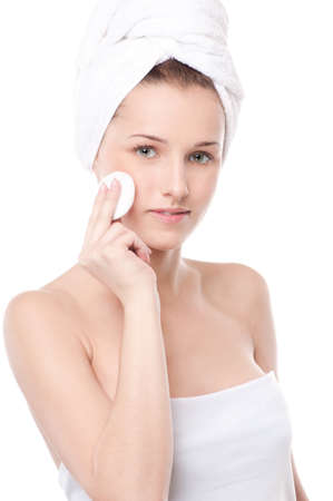 Close-up portrait of young woman with perfect health skin of face, bath towel on head and clean sponge. Isolated on white Stock Photo - 18440240