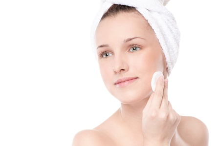 Close-up portrait of young woman with perfect health skin of face, bath towel on head and clean sponge. Isolated on white Stock Photo - 18440271