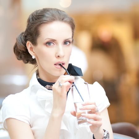 Portrait of beautiful business woman drinking water at office  Stock Photo - 18440269