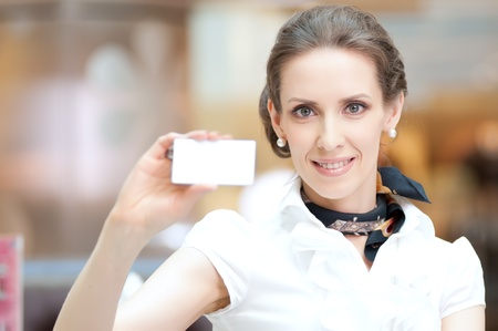 Businesswoman showing and handing a blank business card. Office background. Stock Photo - 18440263