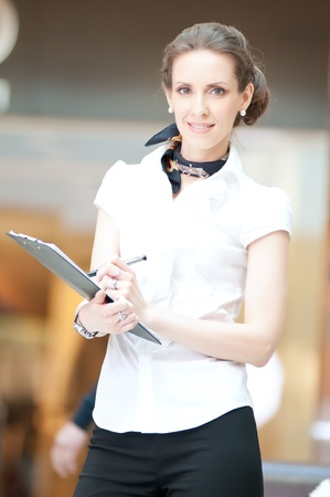 Business woman working with documents: writing with pen Stock Photo - 18440238