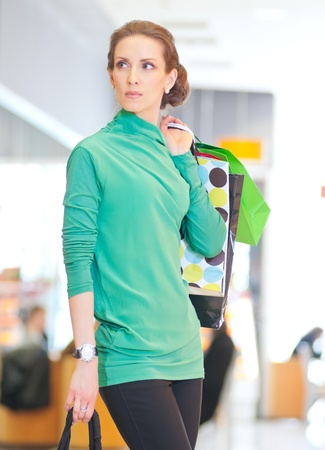Happy woman with shopping bags in mall center. Sales. Stock Photo - 18440266
