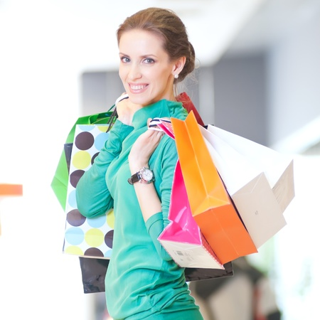 Happy woman with shopping bags in mall center. Sales. Stock Photo - 18440272
