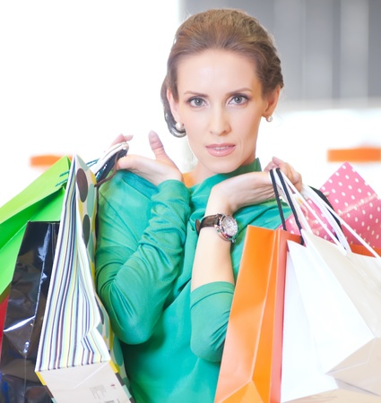 Happy woman with shopping bags in mall center. Sales. Stock Photo - 18440260