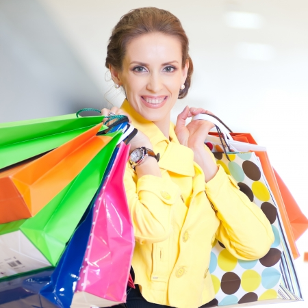 Happy woman with shopping bags in mall center. Sales. Stock Photo - 18440255