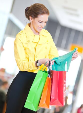 Happy woman with shopping bags in mall center. Sales. Stock Photo - 18440247