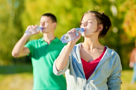 Man and woman drinking water from bottle after fitness sport exercise Stock Photo - 19083740