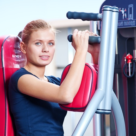 Woman at the gym exercising on a machine  Stock Photo - 19083697