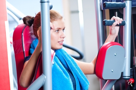 Woman at the gym exercising on a machine Stock Photo - 19083727