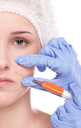 Cosmetic botox injection in the female face. Lips and cheek zone. Isolated on white Stock Photo - 19083729