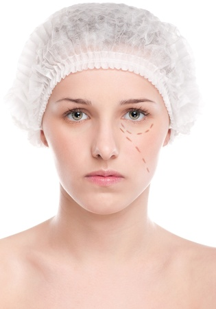 Beautician draw correction lines on woman face. Before plastic surgery operetion. Isolated on white Stock Photo - 19083720