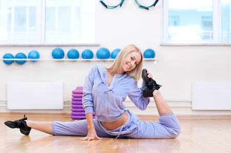 Smiling woman do stretching exercise in sports club. Fitness gym Stock Photo - 19083692