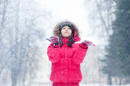 Happy young woman plays with a snow outdoor. Winter day Stock Photo - 19083691