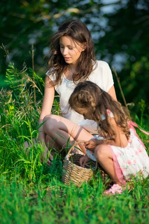 Harvests of berries and mushrooms - lovely girls with the basket of ecological harvests Stock Photo - 19083743