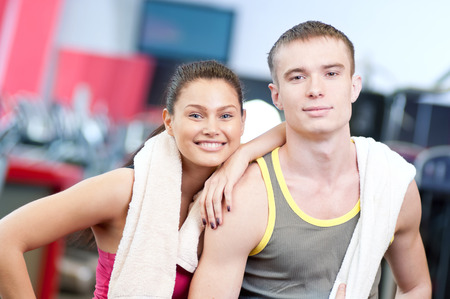 Man and woman after sport exercises. Fitness gym.  photo