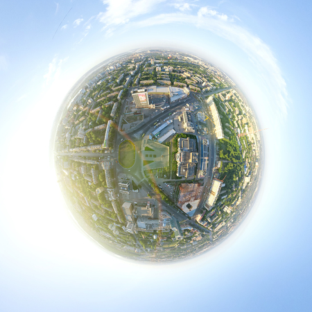 Aerial city view with crossroads, roads, houses, buildings, parks, parking lots, bridges - little planet spherical mode  photo