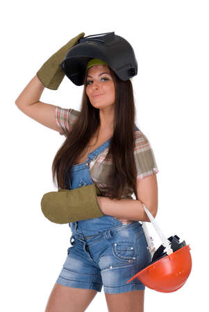 Young female dressed in jeans and weld helmet on white isolated background photo