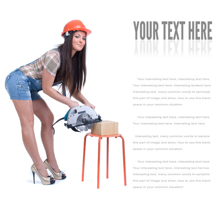 circ saw: Young female dressed in jeans and orange helmet holding an electric circular disk saw On a white isolated background