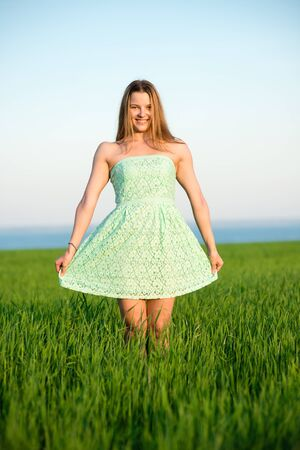 freedom girl: Happy playfull vitality freedom girl stands in green field. Woman lifestyle