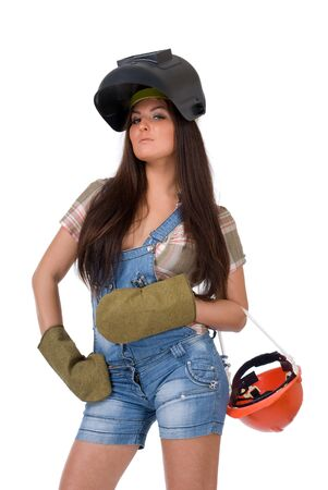 Young sexy female dressed in jeans and weld helmet. White isolated background. Welding mask. photo