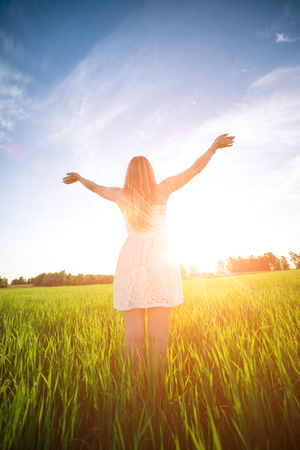 bible flower: Happiness woman stay outdoor under sunlight of sunset Stock Photo