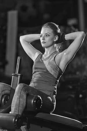 laying abs exercise: Woman doing strength exercises for abs muscles