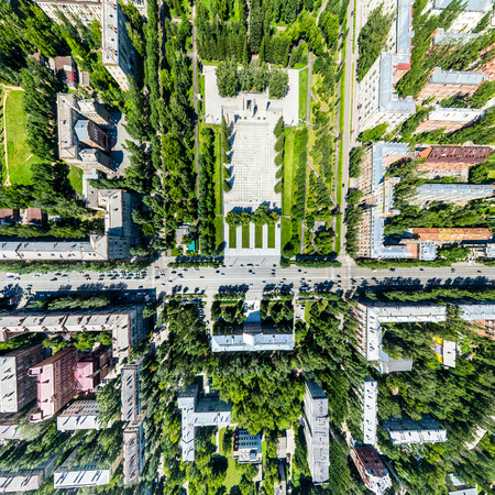 Aerial city view with roads, houses and buildings. Stock Photo