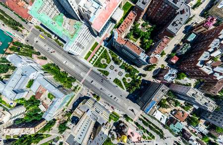 industrial district: Aerial city view with crossroads and roads, houses, buildings, parks and parking lots, bridges. Helicopter drone shot. Wide Panoramic image. Stock Photo
