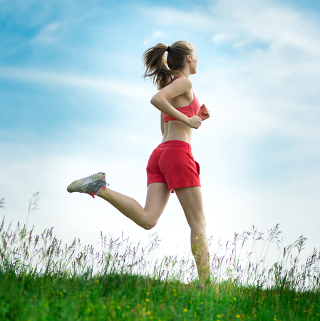 Young woman running summer park rural road. Outdoor exercises. J photo