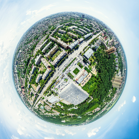 air traffic: Aerial city view with crossroads and roads, houses, buildings, parks and parking lots, bridges. Helicopter drone shot. Wide Panoramic image. Stock Photo