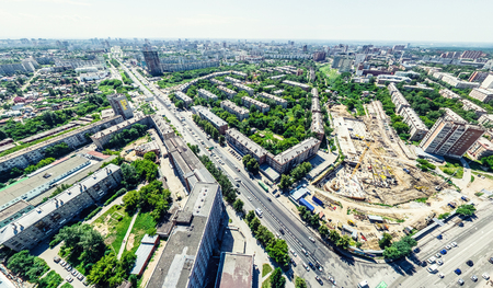 Aerial city view with crossroads and roads, houses, buildings, parks and parking lots, bridges. Helicopter drone shot. Wide Panoramic image. Stok Fotoğraf